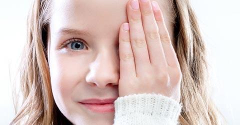 girl covering eye